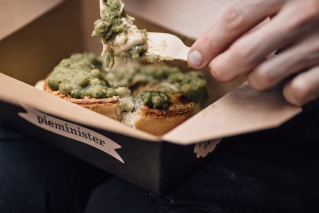 Someone eating a Pieminister pie and mash from a take away box