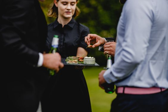 A server handing out Pieminister canapes at an event