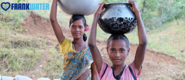 Girls carrying water image