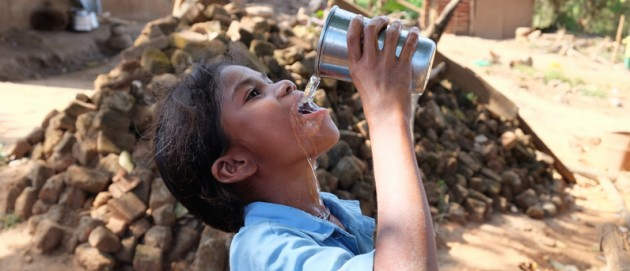 Little girl drinks safe water